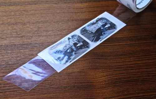 Place tape over photos